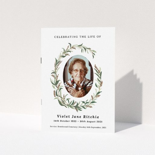 """A funeral order of service named """"elegant wreath. It is an A5 booklet in a portrait orientation. It is a photographic funeral order of service with room for 1 photo. """"elegant wreath"""" is available as a folded booklet booklet, with tones of white and green."""