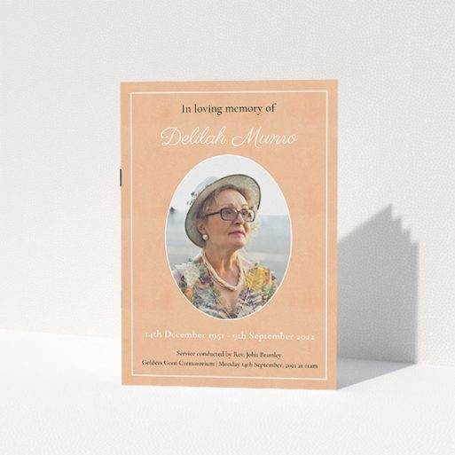 """A funeral order of service named """"Oval Frame. It is an A5 booklet in a portrait orientation. It is a photographic funeral program with room for 1 photo. """"Oval Frame"""" is available as a folded booklet booklet, with splashes of light pink."""