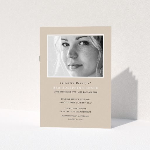 """A funeral order of service design titled """"Peach remembrance"""". It is an A5 booklet in a portrait orientation. It is a photographic funeral order of service with room for 1 photo. """"Peach remembrance"""" is available as a folded booklet booklet, with mainly dark cream colouring."""
