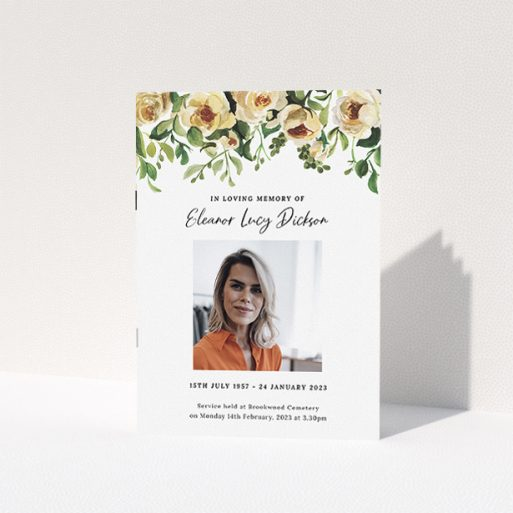 """A funeral order of service named """"yellow roses. It is an A5 booklet in a portrait orientation. It is a photographic funeral program with room for 1 photo. """"yellow roses"""" is available as a folded booklet booklet, with tones of green, light pink and yellow."""