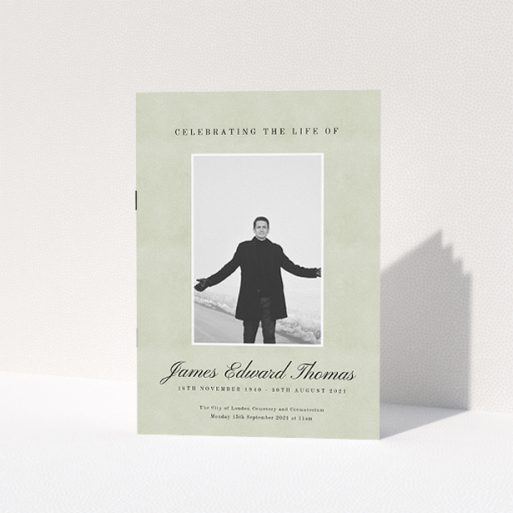 """A funeral order of service named """"Hazy background. It is an A5 booklet in a portrait orientation. It is a photographic funeral program with room for 1 photo. """"Hazy background"""" is available as a folded booklet booklet, with splashes of green."""