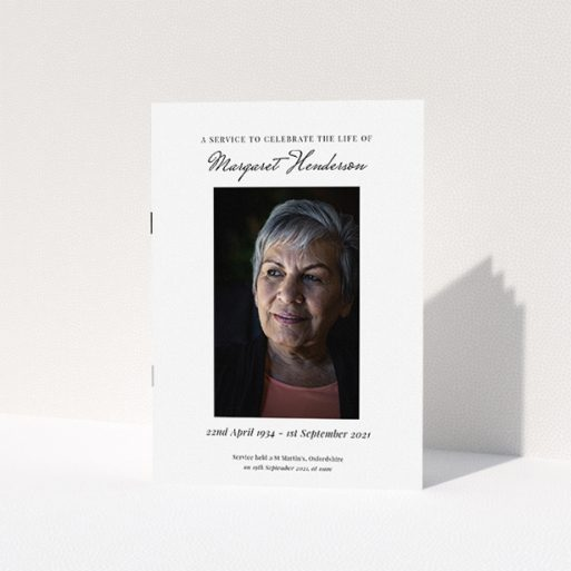 """A funeral order of service named """"Simple Portrait. It is an A5 booklet in a portrait orientation. It is a photographic funeral order of service with room for 1 photo. """"Simple Portrait"""" is available as a folded booklet booklet, with tones of white and black."""