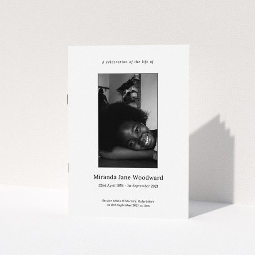 """A funeral order of service named """"Simple Silver. It is an A5 booklet in a portrait orientation. It is a photographic funeral program with room for 1 photo. """"Simple Silver"""" is available as a folded booklet booklet, with tones of white, grey and black."""