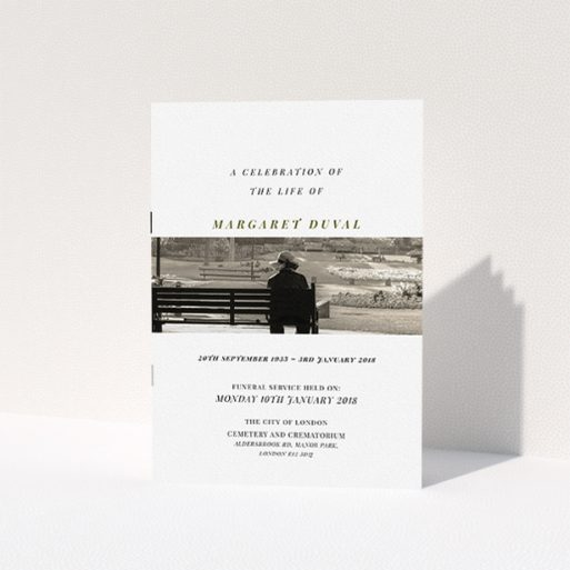 """A funeral service program design titled """"To the horizon"""". It is an A5 booklet in a portrait orientation. It is a photographic funeral service program with room for 1 photo. """"To the horizon"""" is available as a folded booklet booklet, with tones of white and Dark gold."""