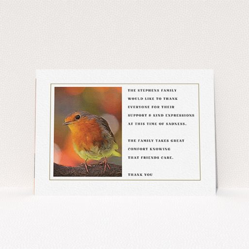 """A funeral thank you card design titled """"Remember Norton"""". It is an A6 card in a landscape orientation. """"Remember Norton"""" is available as a flat card, with tones of gold and red."""