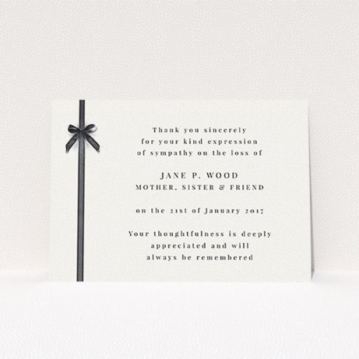 """A funeral thank you card template titled """"Tied gracefully"""". It is an A6 card in a landscape orientation. """"Tied gracefully"""" is available as a flat card, with tones of pale cream and faded black."""