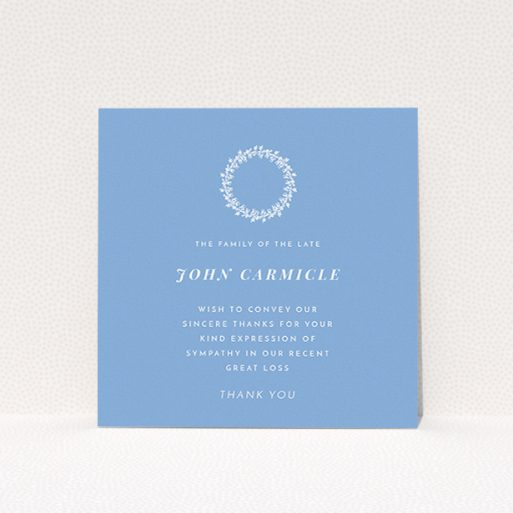 """A funeral thank you card design named """"White Wreath in Blue"""". It is a square (148mm x 148mm) card in a square orientation. """"White Wreath in Blue"""" is available as a flat card, with tones of blue and white."""