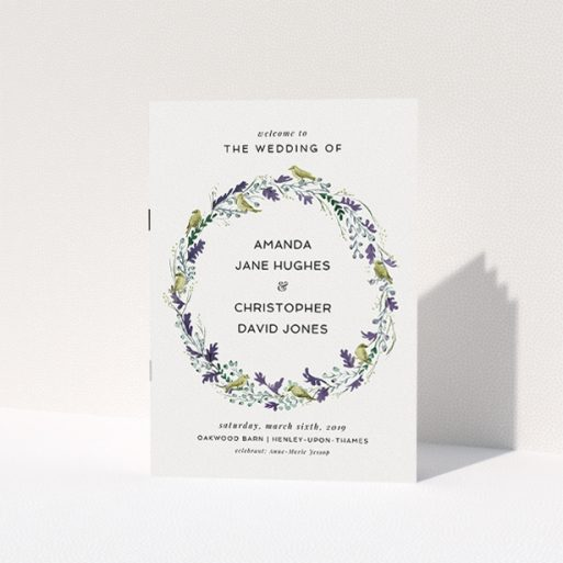 """A multipage wedding order of service design titled """"Vintage Floral Wreath"""". It is an A5 booklet in a portrait orientation. """"Vintage Floral Wreath"""" is available as a folded booklet booklet, with tones of off-white and dark green."""