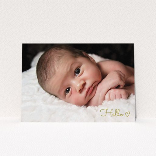 """A new baby announcement card design named """"Hello"""". It is an A5 card in a landscape orientation. It is a photographic new baby announcement card with room for 1 photo. """"Hello"""" is available as a flat card, with mainly gold colouring."""