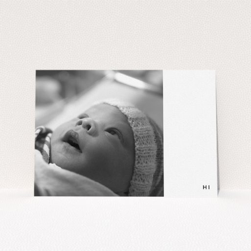 """A new baby announcement card design titled """"HI"""". It is an A5 card in a landscape orientation. It is a photographic new baby announcement card with room for 1 photo. """"HI"""" is available as a flat card, with tones of black and white."""