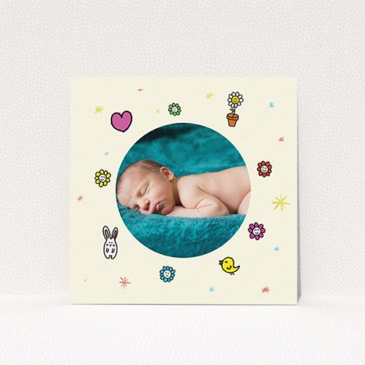 """A new baby announcement card called """"Nursery Frame"""". It is a square (148mm x 148mm) card in a square orientation. It is a photographic new baby announcement card with room for 1 photo. """"Nursery Frame"""" is available as a flat card, with tones of cream, pink and yellow."""