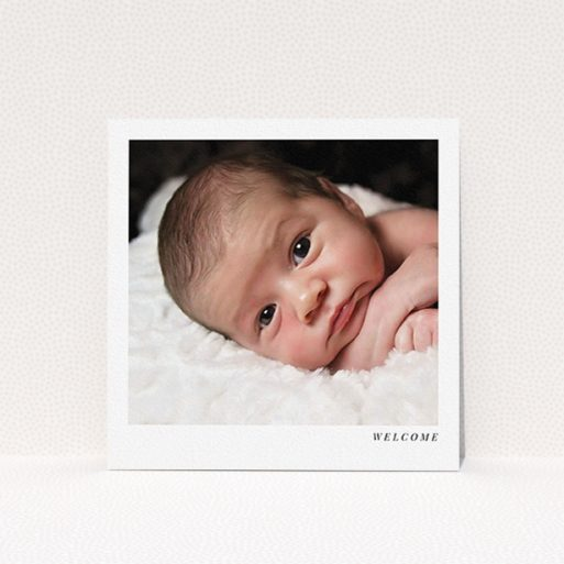 """A new baby announcement card named """"Welcome"""". It is a square (148mm x 148mm) card in a square orientation. It is a photographic new baby announcement card with room for 1 photo. """"Welcome"""" is available as a flat card, with mainly white colouring."""