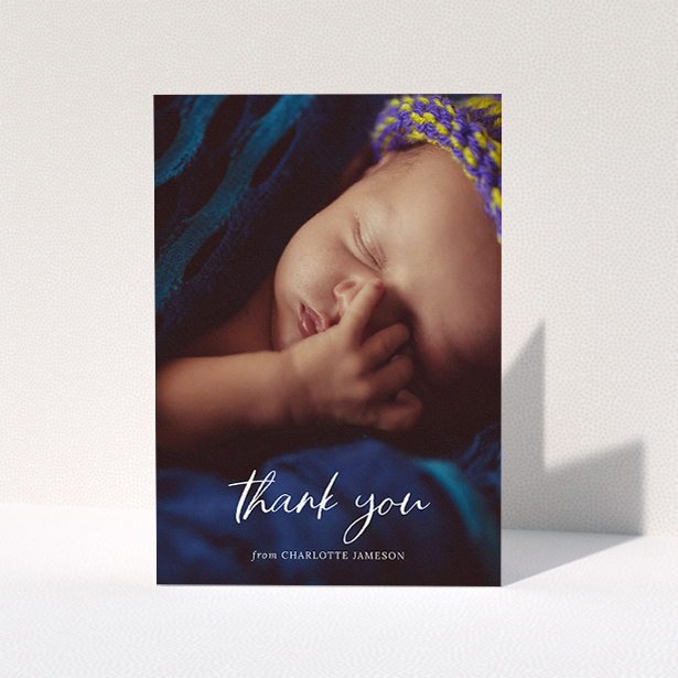 """A new baby thank you card design titled """"Calligraphy Thanks"""". It is an A5 card in a portrait orientation. It is a photographic new baby thank you card with room for 1 photo. """"Calligraphy Thanks"""" is available as a folded card, with mainly white colouring."""