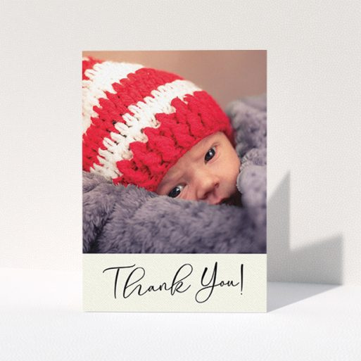 """A new baby thank you card called """"Cursive Thanks"""". It is an A6 card in a portrait orientation. It is a photographic new baby thank you card with room for 1 photo. """"Cursive Thanks"""" is available as a folded card, with mainly cream colouring."""