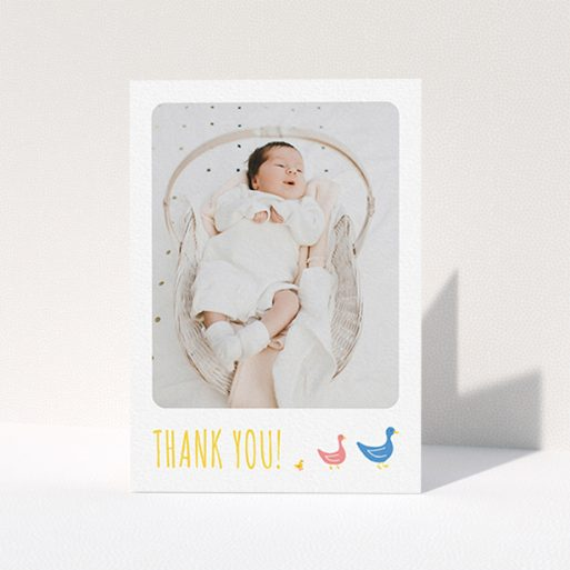 """A new baby thank you card design named """"Family of Ducks"""". It is an A6 card in a portrait orientation. It is a photographic new baby thank you card with room for 1 photo. """"Family of Ducks"""" is available as a folded card, with tones of white, blue and pink."""