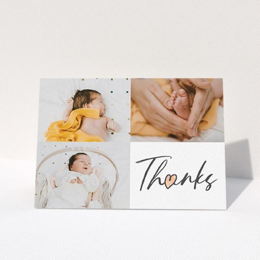 """A new baby thank you card named """"Handwritten Heart"""". It is an A6 card in a landscape orientation. It is a photographic new baby thank you card with room for 3 photos. """"Handwritten Heart"""" is available as a folded card, with tones of black and white."""