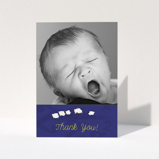 """A new baby thank you card called """"Sleepy Time"""". It is an A6 card in a portrait orientation. It is a photographic new baby thank you card with room for 1 photo. """"Sleepy Time"""" is available as a folded card, with tones of navy blue and white."""