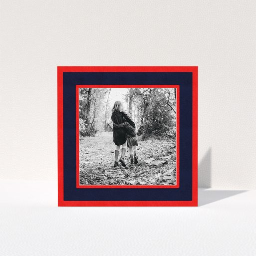 """A personalised christmas card named """"Bold Border"""". It is a square (148mm x 148mm) card in a square orientation. It is a photographic personalised christmas card with room for 1 photo. """"Bold Border"""" is available as a folded card, with tones of red and blue."""