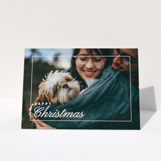 """A personalised christmas card named """"Border Overlay"""". It is an A6 card in a landscape orientation. It is a photographic personalised christmas card with room for 1 photo. """"Border Overlay"""" is available as a folded card, with mainly light pink colouring."""