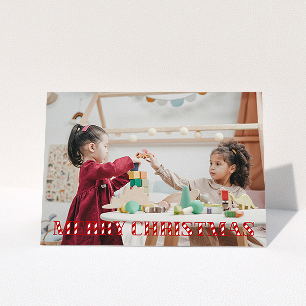 """A personalised christmas card design titled """"Candy Cane"""". It is an A6 card in a landscape orientation. It is a photographic personalised christmas card with room for 1 photo. """"Candy Cane"""" is available as a folded card, with mainly red colouring."""