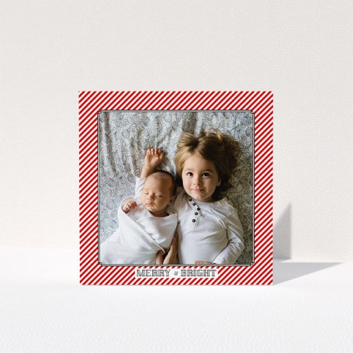 """A personalised christmas card called """"Deco Candy-cane"""". It is a square (148mm x 148mm) card in a square orientation. It is a photographic personalised christmas card with room for 1 photo. """"Deco Candy-cane"""" is available as a folded card, with tones of red and white."""