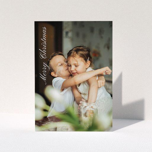 """A personalised christmas card design named """"Elegant Christmas"""". It is an A5 card in a portrait orientation. It is a photographic personalised christmas card with room for 1 photo. """"Elegant Christmas"""" is available as a folded card, with mainly white colouring."""