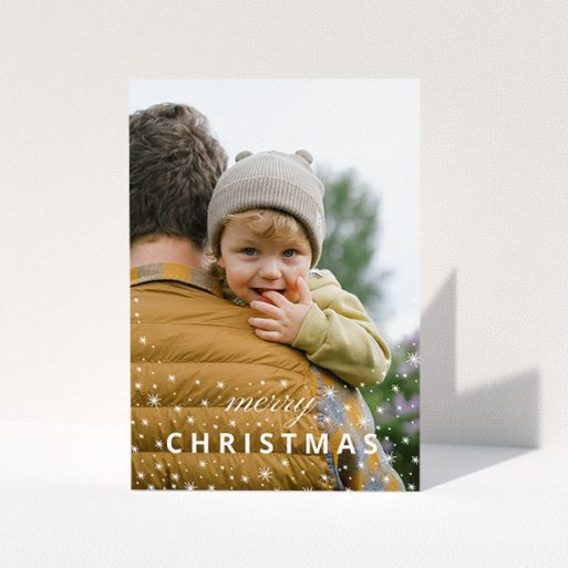 """A personalised christmas card called """"Falling Snow Photo"""". It is an A5 card in a portrait orientation. It is a photographic personalised christmas card with room for 1 photo. """"Falling Snow Photo"""" is available as a folded card, with mainly white colouring."""