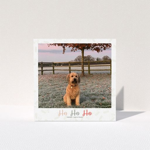 """A personalised christmas card design called """"Ho Ho etc."""". It is a square (148mm x 148mm) card in a square orientation. It is a photographic personalised christmas card with room for 1 photo. """"Ho Ho etc."""" is available as a folded card, with tones of cream, red and pink."""