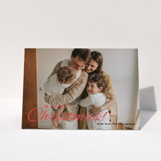 """A personalised christmas card design called """"Merry Christmas Photo"""". It is an A5 card in a landscape orientation. It is a photographic personalised christmas card with room for 1 photo. """"Merry Christmas Photo"""" is available as a folded card, with tones of white and red."""