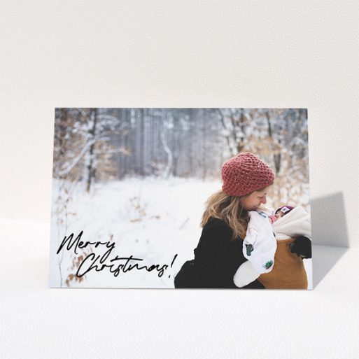 """A personalised christmas card design named """"Signed and Delivered"""". It is an A5 card in a landscape orientation. It is a photographic personalised christmas card with room for 1 photo. """"Signed and Delivered"""" is available as a folded card, with mainly black colouring."""