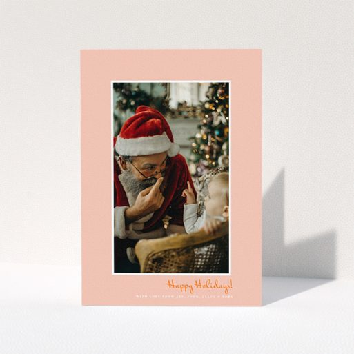 """A personalised christmas card design titled """"Smoked Salmon"""". It is an A5 card in a portrait orientation. It is a photographic personalised christmas card with room for 1 photo. """"Smoked Salmon"""" is available as a folded card, with tones of pink and white."""