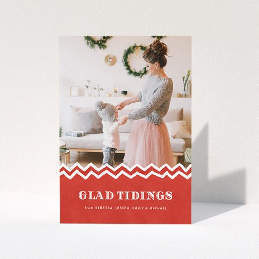 """A personalised christmas card named """"Tidal Tidings"""". It is an A5 card in a portrait orientation. It is a photographic personalised christmas card with room for 1 photo. """"Tidal Tidings"""" is available as a folded card, with tones of red and white."""