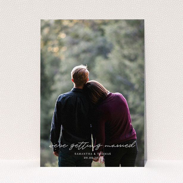 """A personalised wedding invitation called """"Across the Photo"""". It is an A5 invite in a portrait orientation. It is a photographic personalised wedding invitation with room for 1 photo. """"Across the Photo"""" is available as a flat invite, with mainly white colouring."""