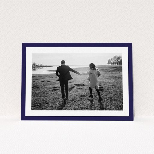 """A personalised wedding invitation named """"Classic Navy Photo Frame"""". It is an A5 invite in a landscape orientation. It is a photographic personalised wedding invitation with room for 1 photo. """"Classic Navy Photo Frame"""" is available as a flat invite, with tones of blue and white."""