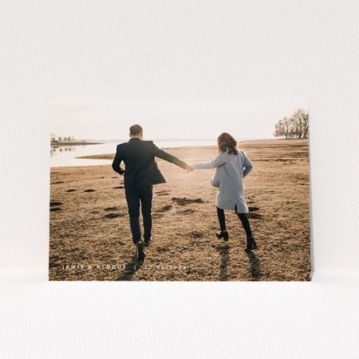 """A personalised wedding invitation called """"Date and Name"""". It is an A5 invite in a landscape orientation. It is a photographic personalised wedding invitation with room for 1 photo. """"Date and Name"""" is available as a flat invite, with mainly white colouring."""