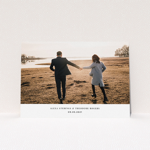 """A personalised wedding invitation design called """"Duke of York Square"""". It is an A5 invite in a landscape orientation. It is a photographic personalised wedding invitation with room for 1 photo. """"Duke of York Square"""" is available as a flat invite, with mainly white colouring."""