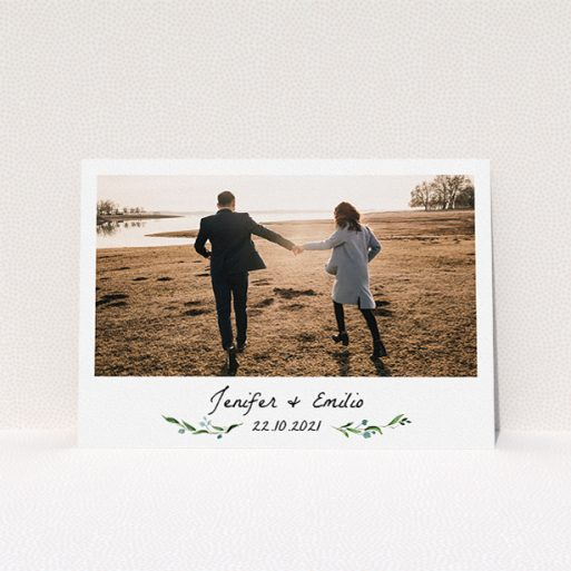 """A personalised wedding invitation template titled """"Floral Fix"""". It is an A5 invite in a landscape orientation. It is a photographic personalised wedding invitation with room for 1 photo. """"Floral Fix"""" is available as a flat invite, with tones of white and light green."""