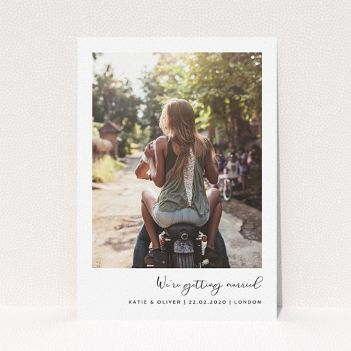 """A personalised wedding invitation design named """"Hoxton Square"""". It is an A5 invite in a portrait orientation. It is a photographic personalised wedding invitation with room for 1 photo. """"Hoxton Square"""" is available as a flat invite, with mainly white colouring."""