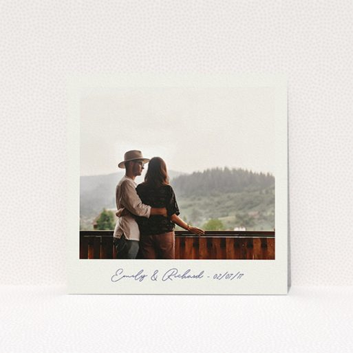 """A personalised wedding invitation called """"Instant Photo Frame"""". It is a square (148mm x 148mm) invite in a square orientation. It is a photographic personalised wedding invitation with room for 1 photo. """"Instant Photo Frame"""" is available as a flat invite, with mainly pale cream colouring."""