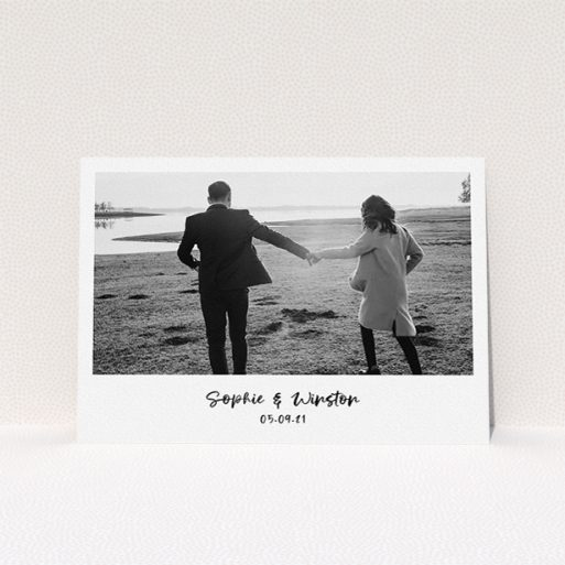 """A personalised wedding invitation called """"Monochrome Photo"""". It is an A5 invite in a landscape orientation. It is a photographic personalised wedding invitation with room for 1 photo. """"Monochrome Photo"""" is available as a flat invite, with mainly white colouring."""