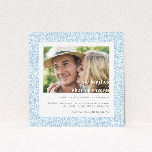 """A personalised wedding invitation design called """"Pastel flower border"""". It is a square (148mm x 148mm) invite in a square orientation. It is a photographic personalised wedding invitation with room for 1 photo. """"Pastel flower border"""" is available as a flat invite, with tones of blue and white."""