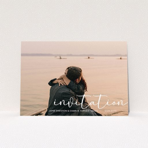 """A personalised wedding invitation design titled """"Salamanca"""". It is an A5 invite in a landscape orientation. It is a photographic personalised wedding invitation with room for 1 photo. """"Salamanca"""" is available as a flat invite, with mainly white colouring."""