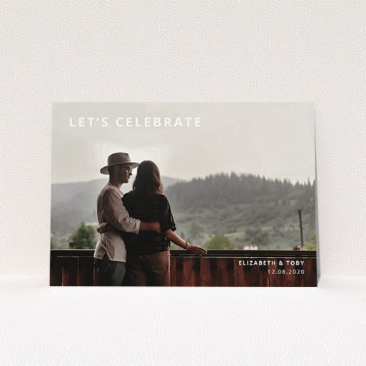 """A personalised wedding invitation design named """"Sans Serif"""". It is an A5 invite in a landscape orientation. It is a photographic personalised wedding invitation with room for 1 photo. """"Sans Serif"""" is available as a flat invite, with mainly white colouring."""