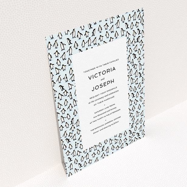 """A personalised wedding invitation called """"Tiny, Tiny Penguins"""". It is an A5 invite in a portrait orientation. """"Tiny, Tiny Penguins"""" is available as a flat invite, with tones of blue and white."""