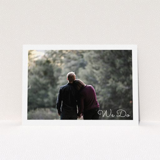 """A personalised wedding invitation called """"We Do Photo"""". It is an A5 invite in a landscape orientation. It is a photographic personalised wedding invitation with room for 1 photo. """"We Do Photo"""" is available as a flat invite, with mainly white colouring."""