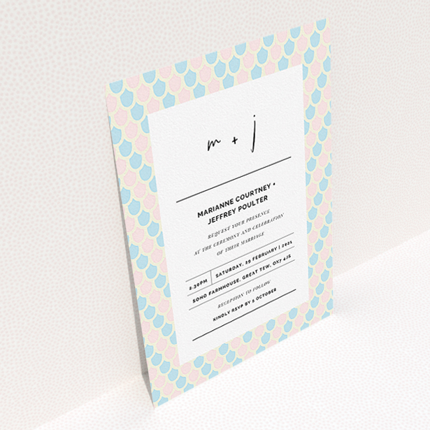 """A personalised wedding invitation named """"Worn Tiles"""". It is an A5 invite in a portrait orientation. """"Worn Tiles"""" is available as a flat invite, with tones of pink, blue and cream."""