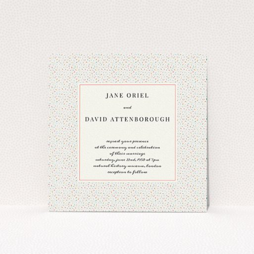 """A personalised wedding invite named """"A hint of confetti"""". It is a square (148mm x 148mm) invite in a square orientation. """"A hint of confetti"""" is available as a flat invite, with tones of cream and red."""
