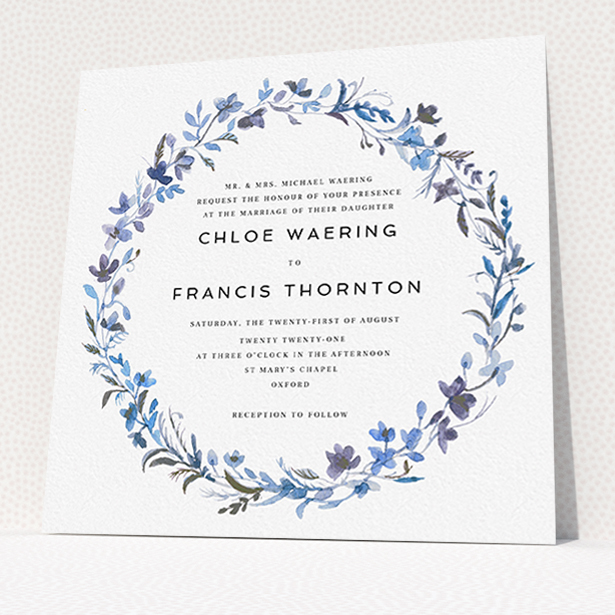 """A personalised wedding invite design titled """"Blue Floral Wreath"""". It is a square (148mm x 148mm) invite in a square orientation. """"Blue Floral Wreath"""" is available as a flat invite, with tones of light blue, purple and grey."""