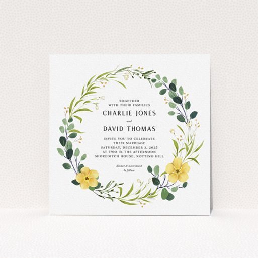 """A personalised wedding invite design called """"Full Summer Wreath"""". It is a square (148mm x 148mm) invite in a square orientation. """"Full Summer Wreath"""" is available as a flat invite, with tones of light green, dark green and yellow."""