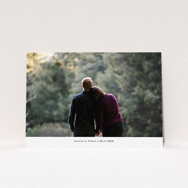 """A personalised wedding invite design named """"Landscape Photo"""". It is an A5 invite in a landscape orientation. It is a photographic personalised wedding invite with room for 1 photo. """"Landscape Photo"""" is available as a flat invite, with mainly white colouring."""